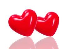 在轻的背景的红色心脏 免版税库存照片