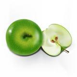 在轻的背景的美丽,绿色苹果 免版税图库摄影