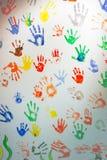 在轻的背景的Handprints 免版税库存图片