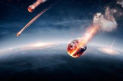 在他们的途中的陨石对地球 免版税库存图片