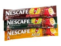 在1的Nescafe 3,与奶油的速溶咖啡和糖 库存照片