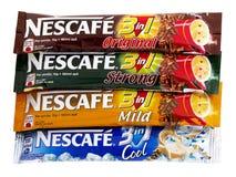 在1的Nescafe 3,与奶油的速溶咖啡和糖 库存图片