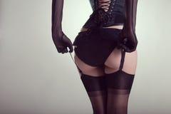 在滑稽的女用贴身内衣裤的性感的女性屁股 库存图片
