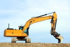在建筑工地的挖泥机 库存照片