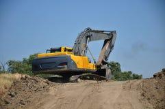在建筑工地的推土机 免版税图库摄影