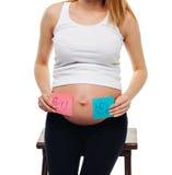 在贴纸的怀孕的腹部男孩和女孩图片,妇女期待婴孩的,家庭和育儿概念 怀孕的年轻人 库存照片