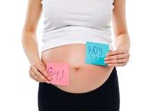 在贴纸的怀孕的腹部男孩和女孩图片,妇女期待婴孩的,家庭和育儿概念 怀孕的年轻人 免版税库存照片