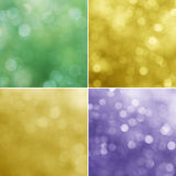 在紫罗兰色,绿色和黄色背景的光 免版税库存照片