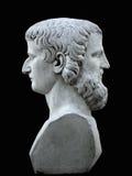 在黑背景的两面神雕塑 免版税库存图片