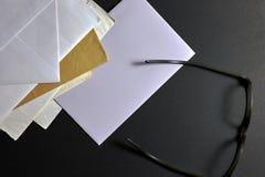 在黑背景的书信 免版税图库摄影