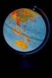 在黑背景的发光的地球 库存图片