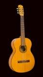 在黑背景的吉他 免版税库存照片