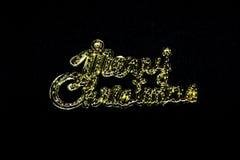 在黑背景的圣诞快乐词 免版税库存照片