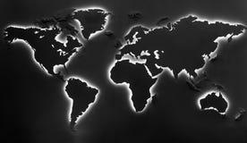 在黑背景的有启发性地球地图 免版税库存图片