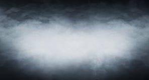 在黑背景的浅兰的烟 库存照片