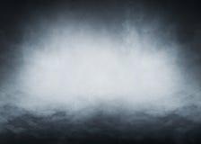 在黑背景的浅兰的烟 免版税库存照片