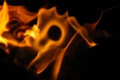 在黑背景的火焰技巧 免版税图库摄影