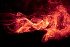 在黑背景的火红色抽象烟设计 库存图片