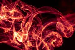 在黑背景的火红色抽象烟设计 免版税库存图片