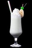 在黑背景的牛奶鸡尾酒 免版税库存照片