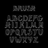 在黑背景的白色手写的书法字母表 做在刷子样式 免版税图库摄影