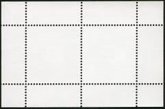 在黑背景的空白的邮票块纪念品板料 库存照片