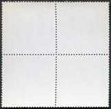 在黑背景的空白的邮票块纪念品板料 图库摄影