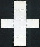 在黑背景的空白的邮票块纪念品板料 免版税库存照片