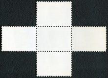 在黑背景的空白的邮票块纪念品板料 免版税图库摄影