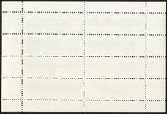 在黑背景的空白的邮票块纪念品板料 免版税库存图片