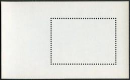 在黑背景的空白的邮票块纪念品板料 库存图片