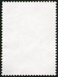 在黑背景的空白的邮票板料 图库摄影