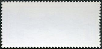在黑背景的空白的邮票 库存图片