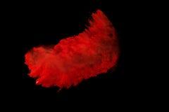 在黑背景的红色五颜六色的粉末飞溅 免版税图库摄影