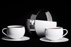 在黑背景的茶具 免版税库存照片