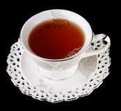 在黑背景的茶杯 免版税库存照片