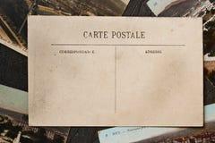 在黑背景的葡萄酒明信片 免版税库存照片