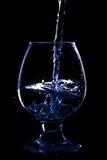 在黑背景的葡萄酒杯 免版税库存图片