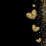 在黑背景的金心脏 免版税库存照片