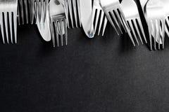 在黑背景的钢叉子 库存图片