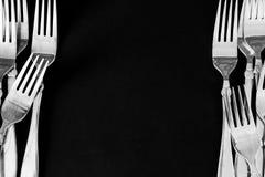 在黑背景的钢叉子 免版税库存照片