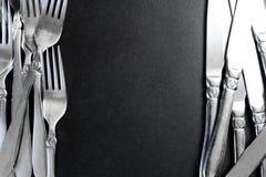 在黑背景的钢叉子 免版税图库摄影