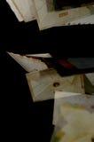 在黑背景的飞行信封 库存图片