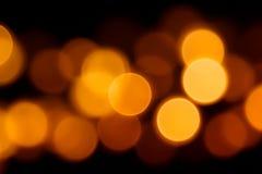 在黑背景的Bokeh橙色圈子为万圣夜 免版税库存图片