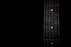在黑背景隔绝的吉他脖子 免版税图库摄影