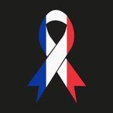 在黑背景隔绝的法国旗子的颜色的丝带 库存图片