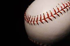 在黑背景-3的棒球 库存图片