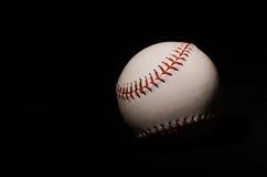 在黑背景-2的棒球 图库摄影
