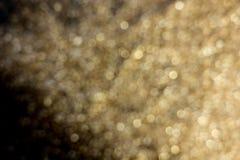 在黑背景blured的砂金装饰 库存照片