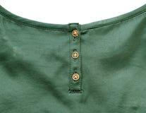 在绿色丝绸布料的金按钮 库存照片